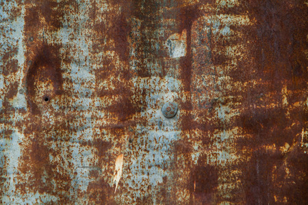 rivets: Close up of corroded iron plates and rivets on a wrecked ship. Background.
