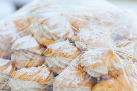 creampuff: Eclairs with cream on plasstic warp for wedding dinner Stock Photo