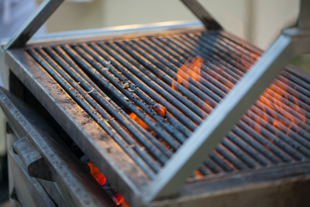 Empty Hot Barbecue Cast Iron Grill With Glowing Charcoal Background Stock Photo