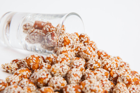 sesame cracker: Roasted peanuts coated with sugar and sesame.