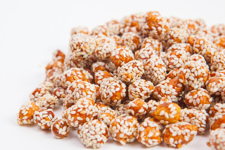 roasted sesame: Roasted peanuts coated with sugar and sesame.