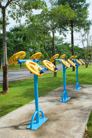 sward: Exercise equipment in public park in the morning at Thailand