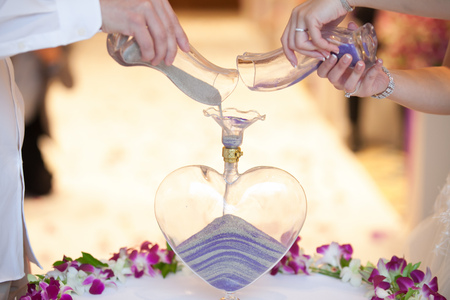 vows: Blending of the sands at wedding ceremony Stock Photo