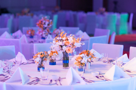 banquet: Elegant banquet table prepared for conference or party and decorated flowers for guests.