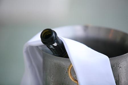 darck: Bottle of wine in ice bucket Stock Photo