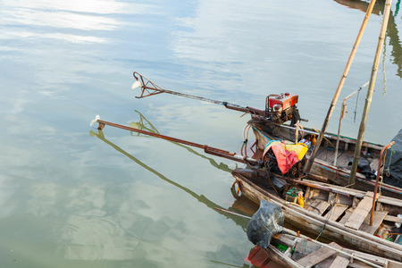 long: thai long tail fishing boat with motor.