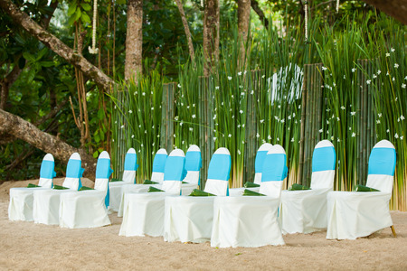marriage ceremonies: floral arrangements located on seats at a wedding ceremony Stock Photo