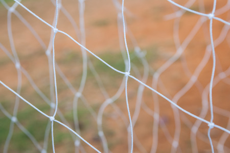 shool: Soccer goal net on blurred background in shool at Thailand.