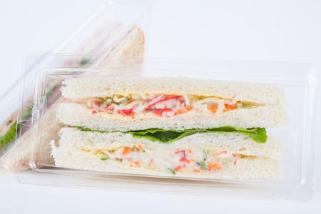 Sandwich in a plastic box on white background Banco de Imagens