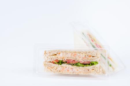 Sandwich in a plastic box on white background Standard-Bild