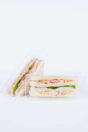 Sandwich in a plastic box on white background Stock Photo