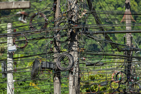 electricity cables in phuket, thailand. close up on the electricity pillar and cable intersections