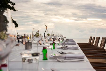 Long table wedding dinner setup on the beach at  Thailand