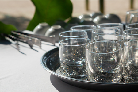 Empty glasses composition on table before celebration at outdoor