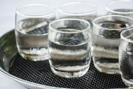 Glass of very cold water ready for guests who attended the wedding.