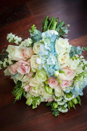 Wedding bouquet lying on wooden floor in bride room. Stock fotó