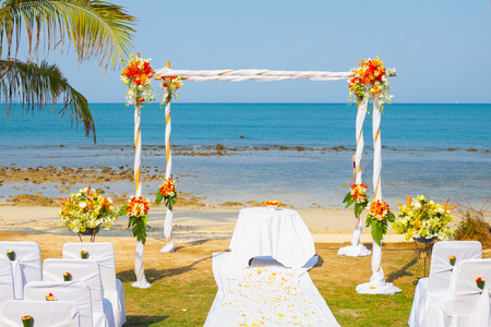 wedding venue, wedding setup,  arch,  decorated with flowers, beach wedding setup