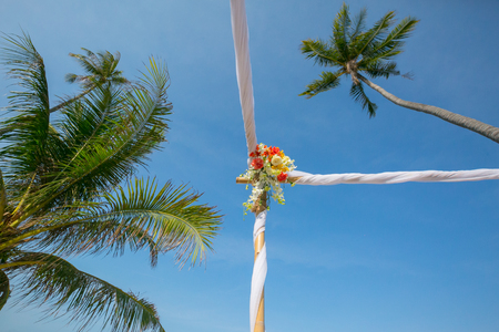 wedding setup,  arch,  decorated with flowers, beach wedding setup