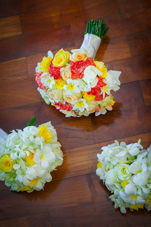 Wedding bouquet lying on wooden floor in bride room. 스톡 콘텐츠