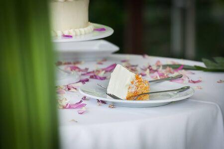 a slice of a wedding cake on dish. 스톡 콘텐츠
