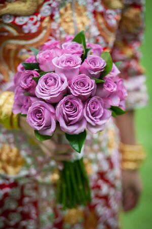 bouquet of rose in the hands of the bride. 스톡 콘텐츠