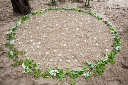 Floral arrangement at a wedding ceremony on beach.
