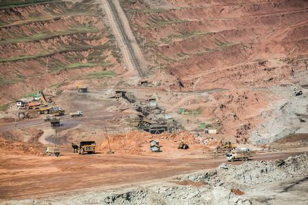Mining dump trucks working in coalmine , Used as a source of electricity generation in the country. Stock Photo