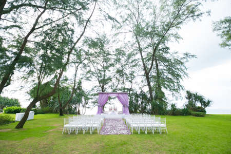 Beautiful wedding ceremony design decoration elements with arch, floral design, flowers and chairs.