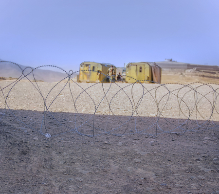 Barbed wire blocking a road near an old fortress in Kabul Afghanistan 免版税图像 - 97530741