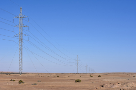 A view of the desert near the coastal town of Swakopmund at the Atlantic Ocean in Namibia Southern Africa with high voltage electricity lines Stock fotó