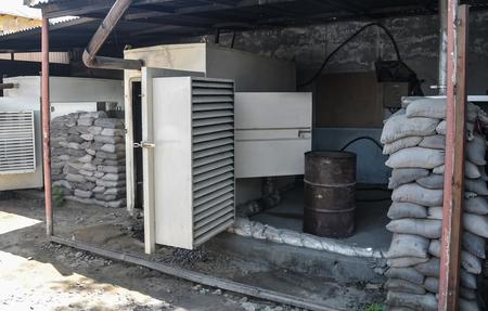 T-walls and sandbags protecting generators in Afghanistan 免版税图像