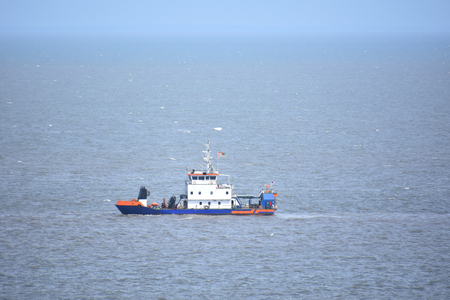 A dredger vessel from Indonesia working in the Indian Ocean near Maputo the capital of mozambique with horizon