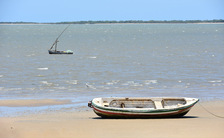 Boats of fishermen near the beach at the Indian Ocean near Maputo the capital of Mozambique