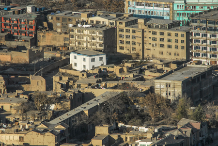An aerial view of the busy city center of Kabul Afghanistan with buildings from the 1960s and 1970s 免版税图像 - 97530717