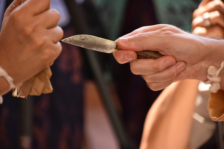 The ceremony with the knife performed during a traditional Balinese wedding 免版税图像 - 96492374