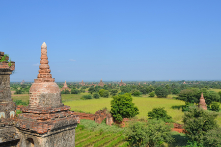 A view of the horizon from the top of a pagoda in Pagan in Burma Myanmar with open grass fields and a horizon with a blue sky