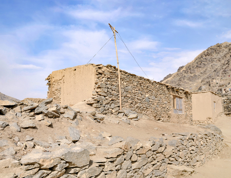 Informal settlements in kabul Afghanistan with building constructed of mud against a blue sky