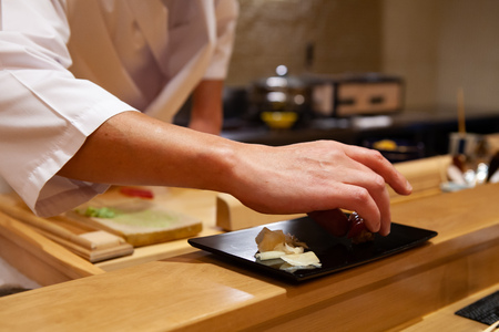 Professional and experienced sushi chef delivered a perfectly made sushi with confident and dedication to a customer. Precision and Finesse at its best practice to achieve top performance in business.