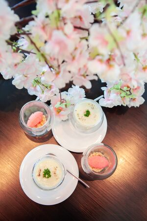 Tasty and delicious Lychee Sorbet and Spinach poached egg with sweet pastel peach and pink of Sakura or Cherry Blossom background. Good for afternoon tea or high tea party or Birthday celebration.