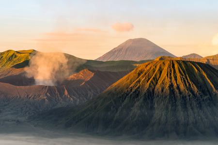 spewing: Mount Bromo spewing volcanic ashes from its crater at Bromo-Tengger-Semeru National Park, East java, Indonesia Stock Photo