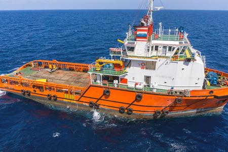 handling: Anchor handling tug deploying anchors of construction barge at oilfield Terengganu, Malaysia Editorial