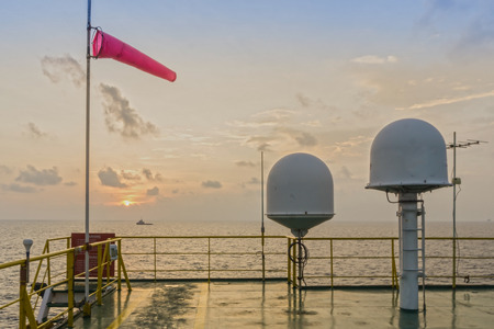 weather gauge: Windsock and communication dome on the construction barge