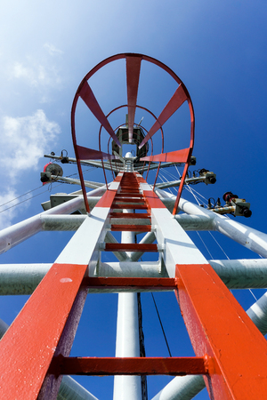 navigational light: Monkey ladder to communication mast on the construction barge Stock Photo