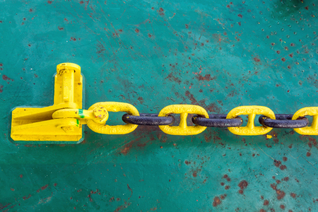 barge: Anchor chain secured to stopper or pad-eye on construction barge Stock Photo