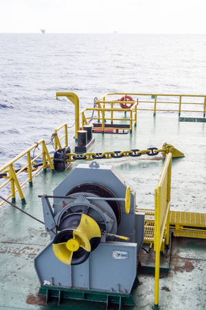 hydraulics: Hydraulic winch for anchor and towing on the bow of a construction barge Editorial