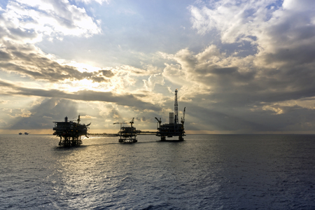 oilrig: Silhouette of oil rig or platform at oil field in the evening