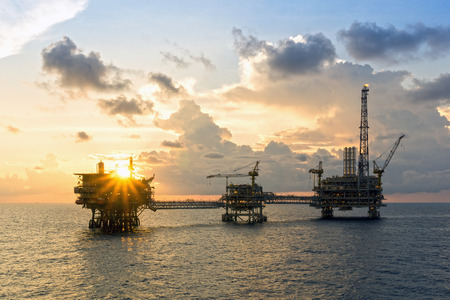 upstream: Offshore oil rigs or production platforms during sunset