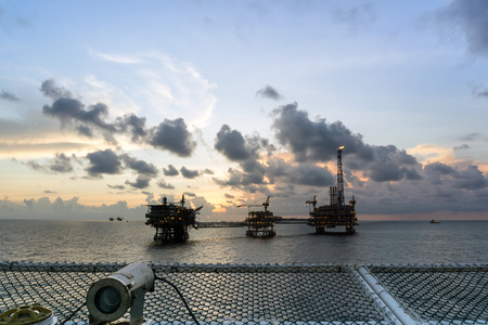 Silhouette of oil rig platform during sunset at oilfield in Malaysia