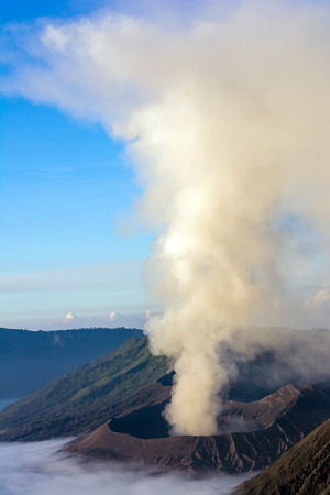 spewing: Mount Bromo spewing volcanic ashes from its crater at Bromo-Tengger-Semeru National Park, Indonesia
