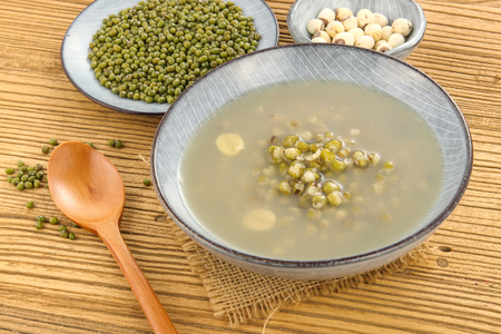 Mung bean soup served in a bowl on wooden table